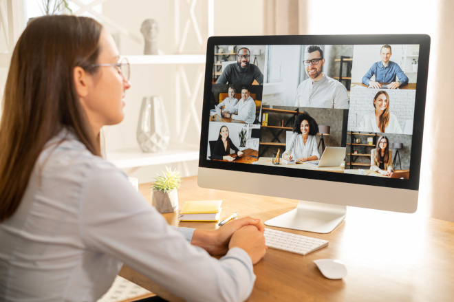 female employee video conference call monitor